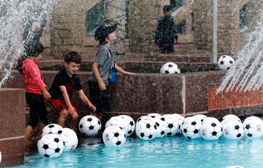 City Hall School Grade 1 students play with hundreds of inflatable soccer balls floating in the city hall wading pool to mark the upcoming FIFA Women's World Cup of Soccer, on Monday, June 1, 2015 in Edmonton, AB. Trevor Robb/Edmonton Sun/Postmedia Network