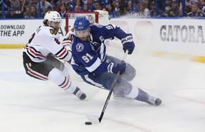 Tampa Bay Lightning captain Steven Stamkos skates with the puck against Chicago Blackhawks defenceman Duncan Keith during Game 2 of the Stanley Cup final on Saturday night. (Kim Klement/USA TODAY Sports)