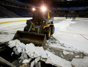 Until next season. A bobcat operator pushes ice into a collector that is below the main floor of the ice surface at Rexall Place in Edmonton on Monday, June 1, 2015. With all activities done for now the ice surface is not needed at this time. Tom Braid/Edmonton Sun/Postmedia Network