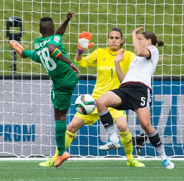 Germany's goalkeeper Nadine Angerer prepares to make a save aginst Binta Diakite of Cote d'Ivoire during action at the FIFA Women's World Cup Canada 2015 at Lansdowne Stadium in Ottawa on Sunday June 7, 2015. Errol McGihon/Ottawa Sun/Postmedia Network