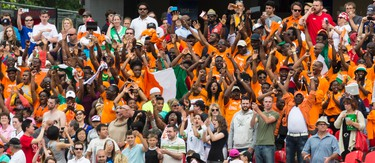Fans from Cote d'Ivoire cheer their team as they play Germany at the FIFA Women's World Cup Canada 2015 at Lansdowne Stadium in Ottawa on Sunday June 7, 2015. Errol McGihon/Ottawa Sun/Postmedia Network