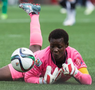 Goalkeeper Lydie Saki of Cote d'Ivoire attempts to make a save against Germany during action at the FIFA Women's World Cup Canada 2015 at Lansdowne Stadium in Ottawa on Sunday June 7, 2015. Errol McGihon/Ottawa Sun/Postmedia Network