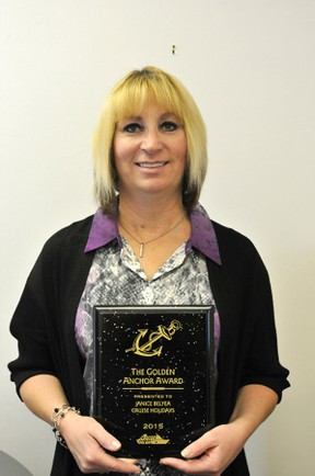 Janice Belyea, owner of a Cruise Holidays travel agency in Drayton Valley, holds her Golden Anchor Award she received in April.
