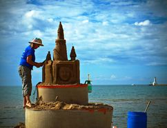 A top summer event is the Cobourg Sandcastle Festival where sculptor Sandi Stirling creates a work of sand art on the beach. (Photo by Stephen Della Casa)