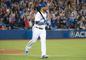Blue Jays batter Edwin Encarnacion reacts after hitting a two-run home run during the ninth inning against the Marlins in Toronto on Tuesday, June 9, 2015. (Nick Turchiaro-USA TODAY Sports)