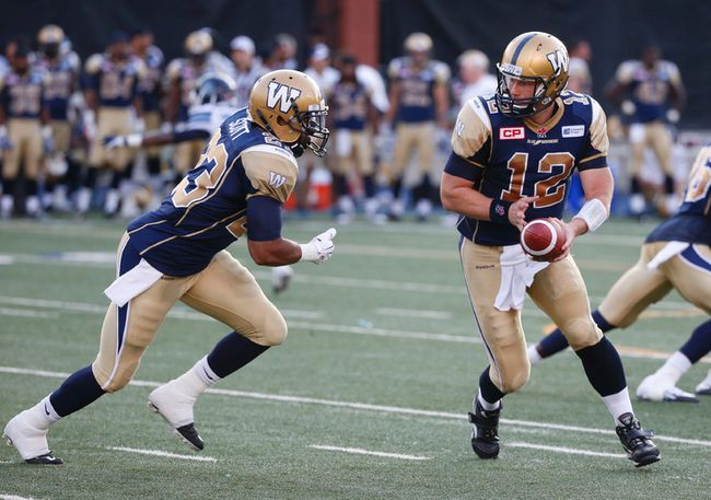 Winnipeg Blue Bombers Brian Brohm, QB (12) hands off to Da'Rel Scott, RB in the first half during CFL pre-season action in Toronto, Ont. at Varsity Stadium on Tuesday June 9, 2015. Jack Boland/Toronto Sun/Postmedia Network