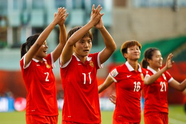 Team China salutes their fans after beating the Netherlands 1-0 during a FIFA Women's World Cup 2015 match at Commonwealth Stadium in Edmonton, Alta., on Thursday June 11, 2015. Ian Kucerak/Edmonton Sun/Postmedia Network