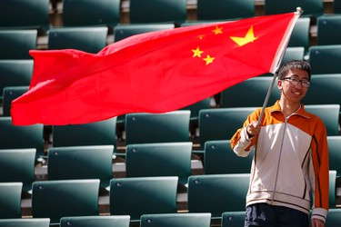 A Chinese fan cheers China during a FIFA Women's World Cup 2015 match against the Netherlands at Commonwealth Stadium in Edmonton, Alta., on Thursday June 11, 2015. Ian Kucerak/Edmonton Sun/Postmedia Network