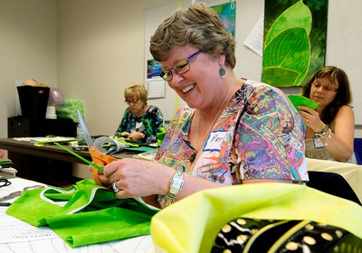 Pat Aldridge takes part in a quilting class during the Edmonton Festival of Quilts at the Central Lion's Senior Recreation Centre, 11113 - 113 St., in Edmonton Alta. on Saturday June 13, 2015. The festival, put on by the Edmonton and District Quilter's Guild, continues Sunday. David Bloom/Edmonton Sun/Postmedia Network