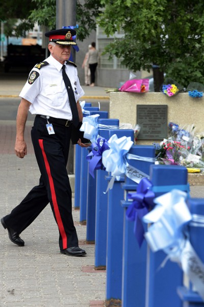 Police Chief Rod Knecht walk pass the blue ribbons and bows that surround the downtown police headquarters in Edmonton , Alberta on Thursday June 11, 2015. Perry Mah/Edmonton Sun/Postmedia Network