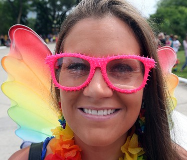 Erin Stanley smiles during the annual Gay Pride Parade in Winnipeg, Man. Sunday June 14, 2015. Brian Donogh/Winnipeg Sun/Postmedia Network