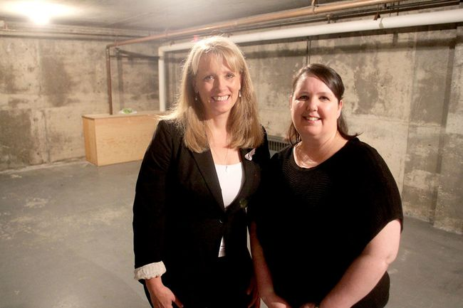 Joan Gowsell, left, and Sherry Lemery, co-presidents of Breast Cancer Action Kingston, stand in the former bomb shelter in their building in Kingston, which they plan to turn into an exercise studio for women recovering from breast cancer. (Michael Lea/The Whig-Standard)