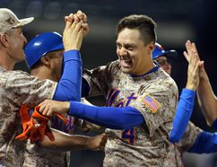 New York Mets shortstop Wilmer Flores, right, celebrates his game-winning hit against the Toronto Blue Jays with teammates at Citi Field. The Mets defeated the Blue Jays 4-3 in eleven innings. (Brad Penner-USA TODAY Sports)