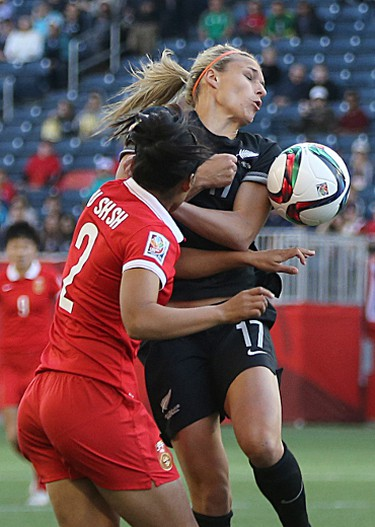 New Zealand forward Hannah Wilkinson (right) is called for a hand ball during the FIFA Women's World Cup Canada 2015 game against China in Winnipeg on Mon., June 15, 2015. Kevin King/Winnipeg Sun/Postmedia Network