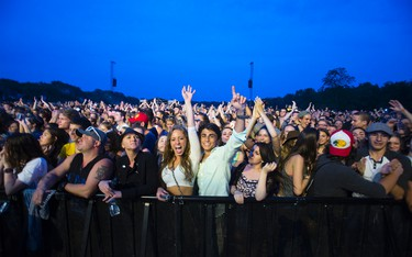 Concert goers cheer for Mumford and Sons who thrilled a packed park at Butler's Barracks in Niagara-on-the-Lake on Monday, June 15, 2015. Julie Jocsak/ St. Catharines Standard /  Postmedia Network