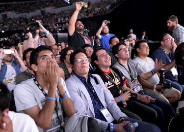 Attendees react during a video game presentation at the Sony Playstation E3 conference in Los Angeles June 15, 2015. REUTERS/Kevork Djansezian