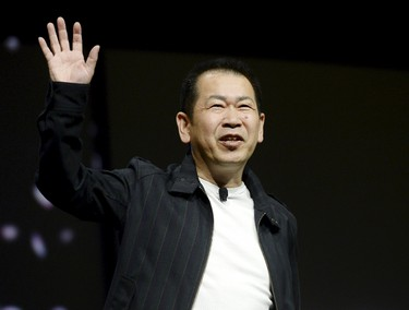 """Japanese game designer Yu Suzuki, creator of the video game """"Shenmue 3"""", waves to the audience at the Sony Playstation E3 conference in Los Angeles June 15, 2015. REUTERS/Kevork Djansezian"""
