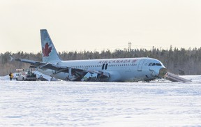 Crews work on the Airbus A320 that was flown as Air Canada Flight 624 which slid off a runway at the end of Halifax Stanfield Airport in Enfield, Nova Scotia, March 29, 2015.  The Air Canada plane slid off a runway and suffered heavy damage while landing in the east coast city of Halifax on Sunday, sending more than 20 passengers and crew to hospital with non-life threatening injuries. The incident happened shortly after midnight. The airline said in an update on Sunday afternoon that all but one of those admitted to hospitals had now been released.  REUTERS/Mark Blinch