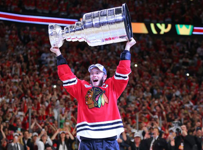 Winnipeg's Jonathan Toews, captain of the Chicago Blackhawks, hoists the Stanley Cup for the third time Monday night at the United Center. Toews is already in elite company in terms of Cups won by NHL captains. (Dennis Wierzbicki/USA TODAY Sports)
