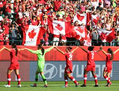 Canada's players salute the crowd after defeating China during the Women's World Cup in Edmonton on Saturday, June 6, 2015. (Perry Mah/Postmedia Network)