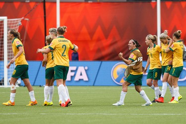 Australia players celebrate their 1-1 tie against Sweden at the end of a FIFA Women's World Cup 2015 match at Commonwealth Stadium in Edmonton, Alta., on Tuesday June 16, 2015. Ian Kucerak/Edmonton Sun/Postmedia Network