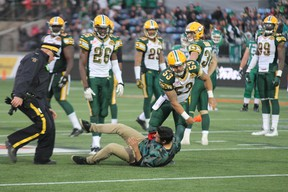 Edmonton Eskimos long snapper Ryan King throws a fan down on the ground in Fort McMurray Alta. on Saturday June 13, 2015. Robert Murray/Fort McMurray Today/Postmedia Network