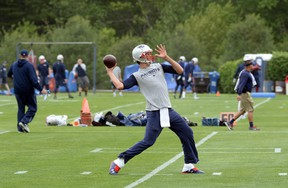 Tom Brady of the New England Patriots throws a ball during organized team activities at Gillette Stadium on June 4, 2015 in Foxborough, Mass. (Darren McCollester/Getty Images/AFP)