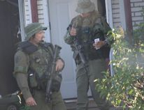Heavily armed police responded to an incident on Frances Street in Tillsonburg early Saturday, June 20, 2015. One man was later arrested and taken into custody. (CONTRIBUTED PHOTO)