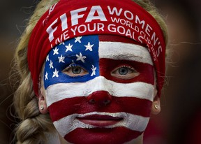 A USA fan watches the team warm up prior to a Group C football match between Nigeria and USA at BC Place Stadium in Vancouver during the FIFA Women's World Cup Canada 2015 on June 16, 2015.  AFP PHOTO/ANDY CLARK