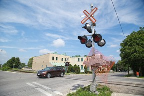 The CPR says its move to install warning lights and barriers at the Piccadilly and St. George streets rail crossing in London, billed as ?high-risk? by critics, is unrelated to a crash that injured a motorist last month. (DEREK RUTTAN, The London Free Press)