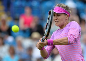 Eugenie Bouchard returns the ball to Alison Riske of the US during their women's singles second round match at the WTA Eastbourne International tennis tournament in Eastbourne, southern England on June 23, 2015. Bouchard won 7-6, 6-3.  AFP PHOTO / GLYN KIRK