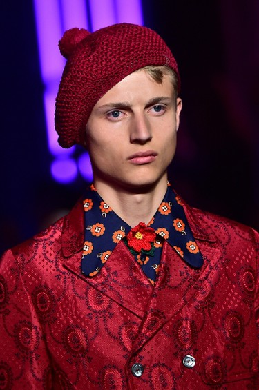 A model presents a knit hat and flower print blouse by Gucci at the Men Spring-Summer 2016 Milan's Fashion Week.