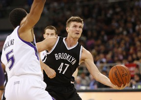 Andrei Kirilenko (right) of the Brooklyn Nets handles the ball against Ryan Hollins of the Sacramento Kings during the 2014 NBA Global Games at the MasterCard Centre in Beijing on October 15, 2014, (AFP PHOTO)