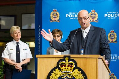 Peter Clissold (right), director of the Edmonton Police Service's Security Management Branch, speaks about police body worn cameras during an EPS news conference at EPS Headquarters in Edmonton, Alta., on Tuesday June 23, 2015. Police released the results of a three year study to assess the effectiveness of body worn video at the conference. Ian Kucerak/Edmonton Sun/Postmedia Network