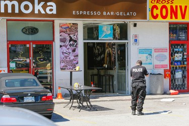 York Regional Police at the Moka Cafe, on Islington Ave., just south of Hwy. 7 in Vaughan where a gunman walked in and started shooting, killing two people on scene and wounding two others on June 24, 2015. (Dave Thomas/Toronto Sun)