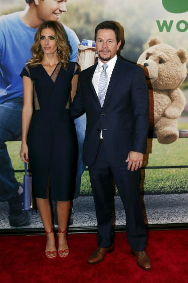 """Cast member Mark Wahlberg and his wife Rhea Durham pose on the red carpet of the movie premiere of """"Ted 2"""" in New York June 24, 2015.     REUTERS/Shannon Stapleton"""