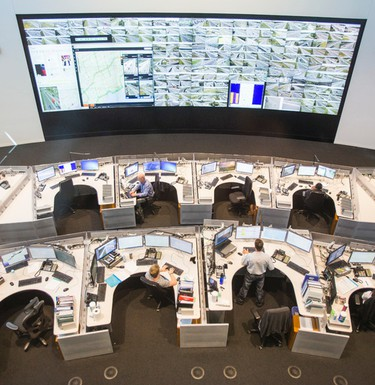 MTO operators keep an eye on the video wall showing 240 traffic camera at the MTO Compass Centre on June 24, 2015. The wall monitors traffic in Ontario's central region located in Toronto, Ont. (ERNEST DOROSZUK/TORONTO SUN).
