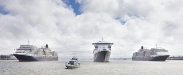 Cunard's reigning three queens, from left, Queen Elizabeth, Queen Mary and Queen Victoria line up on the River Mersey in Liverpool. CHRIS ISON PHOTO