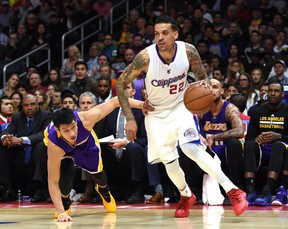 Matt Barnes of the Los Angeles Clippers dribbles away from Jeremy Lin of the Los Angeles Lakers at Staples Center on April 7, 2015 in Los Angeles. (Harry How/Getty Images/AFP)