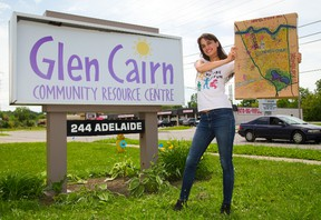 Sylvia Nagy of London, a social work student at Kings University College, shows off a painting of a map of Glen Cairn Thursday. Nagy won an $1,000 Awesome London grant for her community building plan. Mike Hensen/The London Free Press