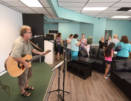 Musician Steve Adair performs for guests at Friday's grand re-opening of the Stratford Youth Centre. SCOTT WISHART/The Beacon Herald