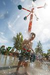 Nathan Cardinal, 2, plays in the splash park on a hot day at Jackie Parker Recreation Park in Edmonton, Alta., on Friday June 26, 2015. Alberta Health Services has warned about plus-30 degress Celcius days over the next four days. Ian Kucerak/Edmonton Sun