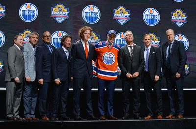 Jun 26, 2015; Sunrise, FL, USA; Connor McDavid poses with team executives after being selected as the number one overall pick to the Edmonton Oilers in the first round of the 2015 NHL Draft at BB&T Center. Mandatory Credit: Steve Mitchell-USA TODAY Sports