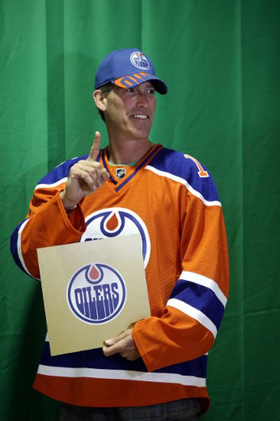 Geoff Thompson gets his picture taken with the golden draft card at the Edmonton Oiler Draft Party at Rexall Place in Edmonton, Alberta Friday, June 26, 2015.Perry Mah/Edmonton Sun/Postmedia Network