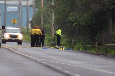 Ottawa -- Police shown investigating the scene of a hit and run crash that killed a male cyclist Sunday, June 28, 2015 on Leitrim Road at Gilligan Road near Albion Road. The cyclist was declared dead upon arrival at the Ottawa Hospital Civic campus. DANI-ELLE DUBE/Ottawa Sun/Postmedia Network