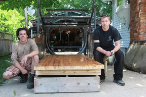 Jeff Wickens, right, who runs Hi-Way Bowl on London Line, and newly-hired mechanic Sean Burr are setting up an outdoor bowling lane in Wickens' driveway at 16 Alfred St. in Point Edward to raise funds for the Canadian Cancer Society. The lane will be open to the public on Canada Day in an informal setting, with donations for cancer accepted, followed by a tournament at 5 p.m. (Terry Bridge/Sarnia Observer/Postmedia Network)