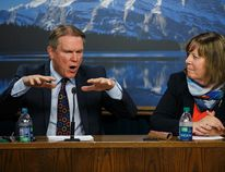 Dave Mowat (left), president and CEO of ATB Financial, and Marg McCuaig-Boyd, Energy Minister, speak about Mowat's appointment as head of a royalty review advisory panel at the Alberta Legislature in Edmonton on Friday. Mowat will begin recruiting panel members and the panel will deliver its report at the end of the year. Ian Kucerak/Edmonton Sun