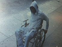 In this Monday, June 29, 2015 photo provided by the New York Police Department, a man gets away after he robbed the Santander bank in the Queens borough of New York. (NYPD/AP/HO)
