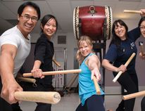 John Nguyen, left, Anny Lin, Teri-Lynn Krezanoski, Yoshiko Shimizu and Sara Pun, members of the Japanese drumming group Midnight Taiko, pose by their drums during a practise in Calgary on June 22.