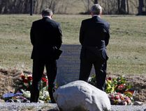 Lufthansa Chief Executive Carsten Spohr (L) and Germanwings Managing Director Thomas Winkelmann carry flowers as they pay their respects at the memorial for the victims of the air disaster in the village of Le Vernet, near the crash site of the Germanwings Airbus A320 in French Alps April 1, 2015. REUTERS/Jean-Paul Pelissier